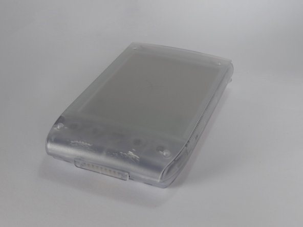 Remove the outer screen cover by releasing  the top clip from the main body of the device.