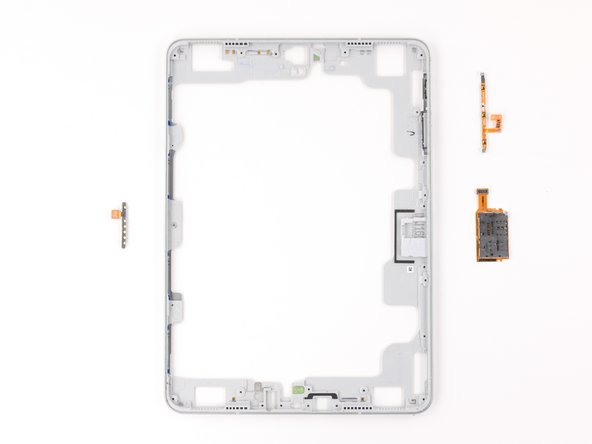 One piece of the midframe houses the microSD slot, the volume buttons, and copper pads.