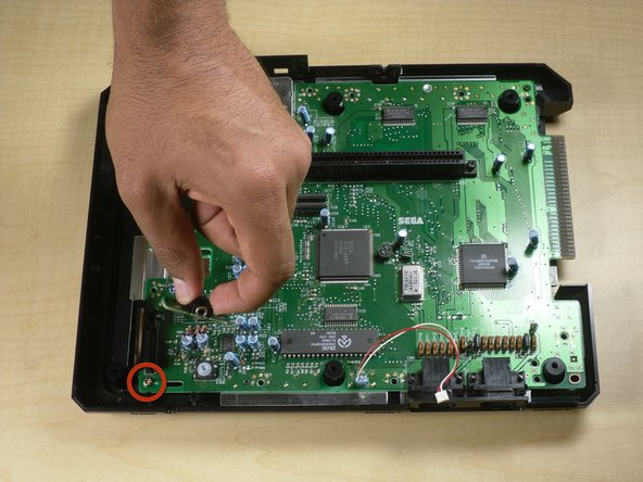 Remove single golden screw on motherboard using Philips screwdriver.