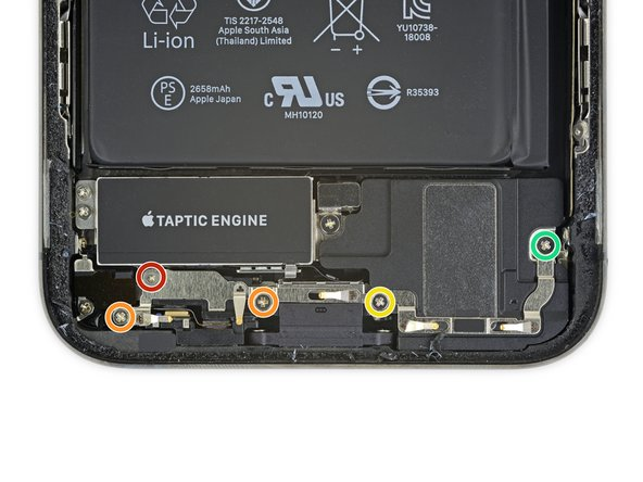 Remove the five screws securing the two brackets below the Taptic Engine and main speaker: