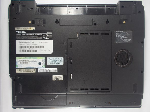 Flip the laptop over and orient it so that the battery faces away from you.