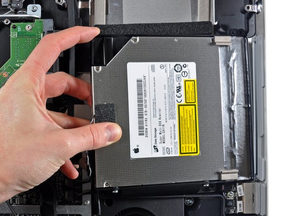 Lift the inner edge of the optical drive and maneuver its connector past the frame attached to the logic board.
