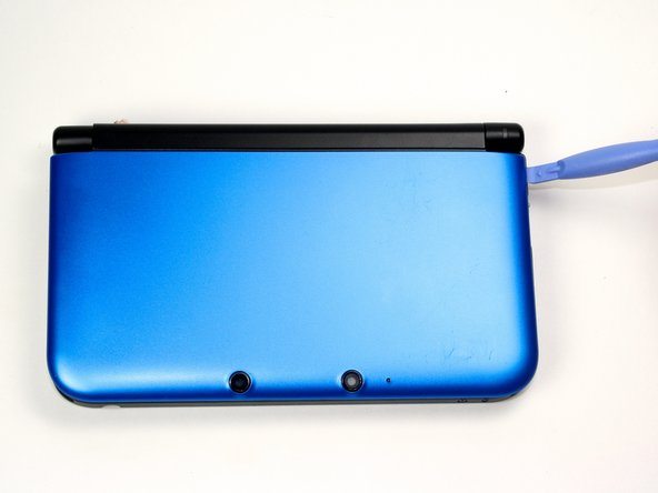 Once the top case is loose and unclipped, remove it from the DS.