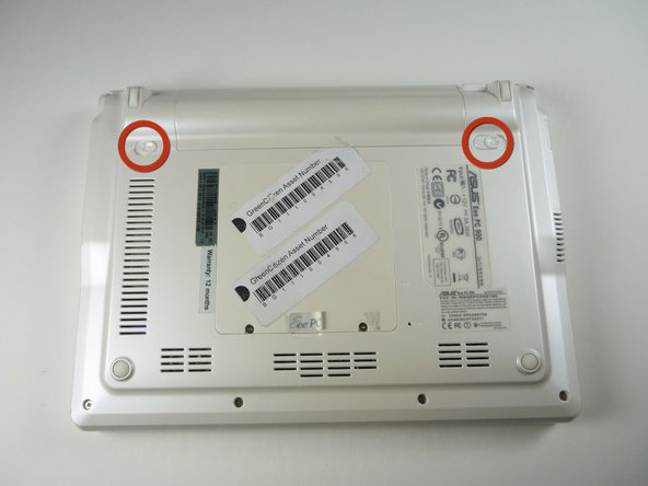 Faites glisser les loquets de verrouillage de la batterie en position déverrouillées.