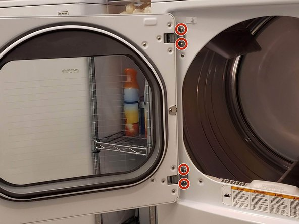 Hold the door while removing it from the dryer so that it doesn't fall and break.