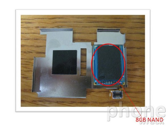 The one thing we knew the phone had but couldn't find was the 8GB internal memory. Where could it be? We eventually found it hiding underneath the shield covering the processor side of the PCB - very sneaky!