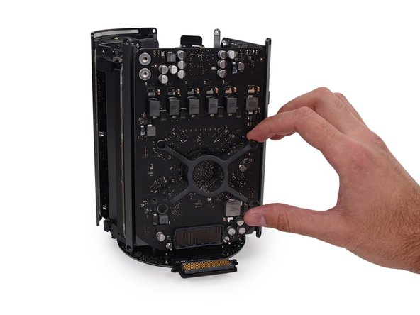 With the Mac Pro's structure dominated by the central heat sink, we'd best start by peeling parts off.