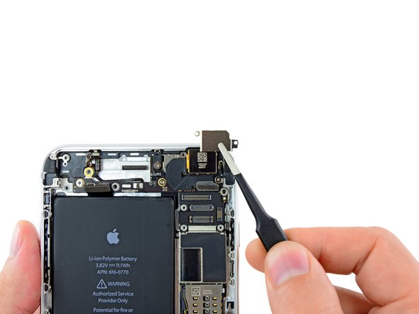 Lift and remove the rear-facing camera bracket off the rear-facing camera.