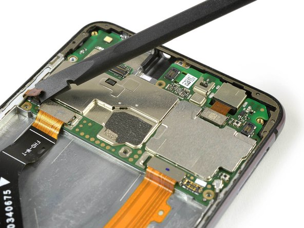 Use a spudger to disconnect the volume and power button, the display and the main flex cable.