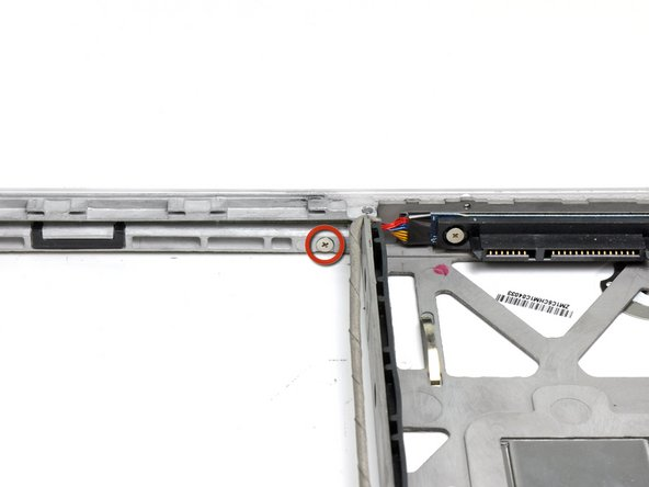 Remove the single 3.1 mm Phillips screw below the inside of the optical drive opening.