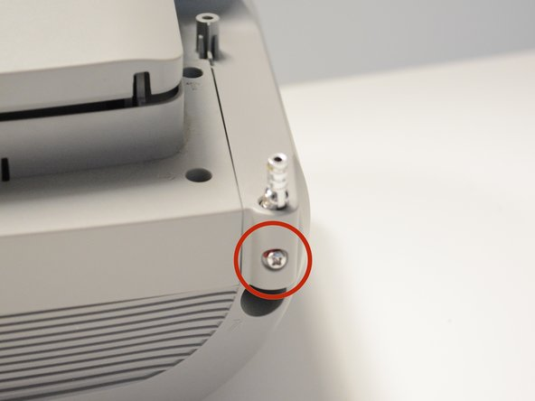 Locate the screw on the back of the radio, in the right hand corner Remove the screw holding the antenna in place