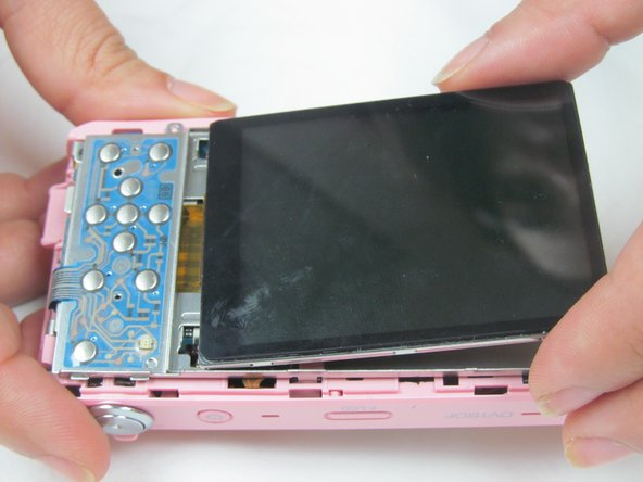 Remove the outer casing holding the back part of the camera together. Leave on the front casing.