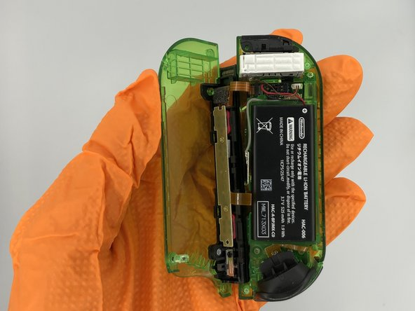 Flip open the back shell to expose the battery.