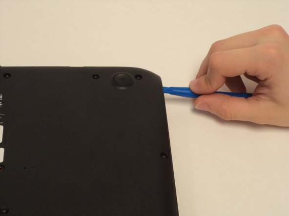 Lift the back panel using a plastic opening tool.  Slowly make your way around the device until the back panel comes off.