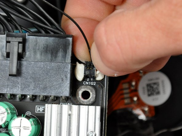 The single-wire connector near the upper left corner of the power supply is small and held very tightly in its socket, making it inherently difficult to remove. Be sure to pull only on the connector during removal, as pulling the cable will surely cause it to break.