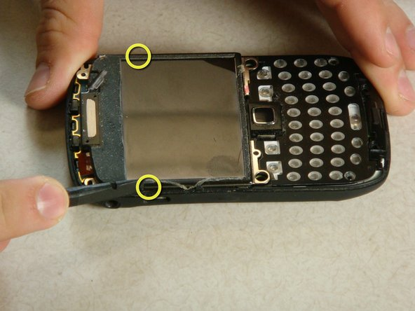 There are two clips on each side of the phone. Insert a plastic spudger between the clips and the screen.