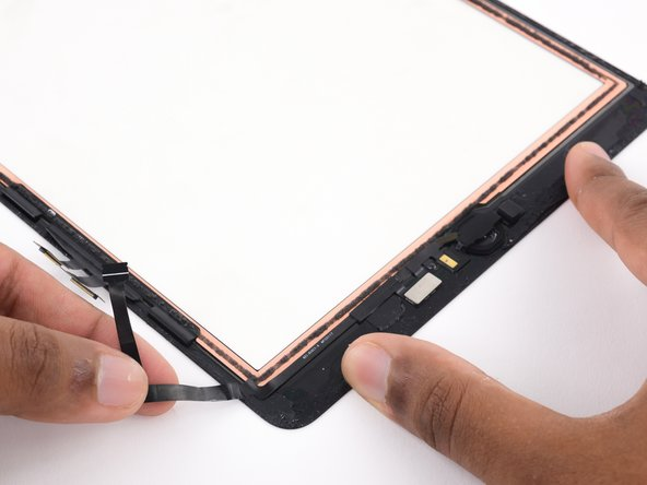 Gently begin peeling the home button cable off the back of the front panel.