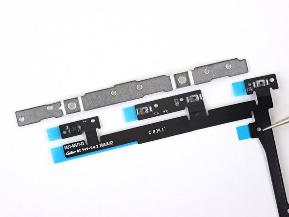 When reinstalling a new side button flex cable, align the holes in the flex cable with the holes on the button bracket, remove the adhesive backings, and press to secure.