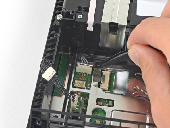 Use your fingers or a pair of tweezers to disconnect the optical drive cable from the motherboard.