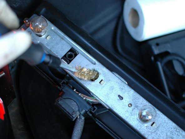 Before installing the new bulb consider cleaning the socket with a soft metal wire brush such as the brass brush shown to help remove any corrosion.