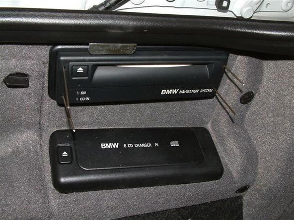 Different BMW models require a slightly different process to remove the navigation computer however all are generally the same.  The following photos show removing the navigation computer in a BMW E38 7 Series