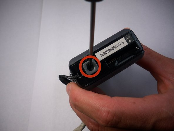 Take off camera mount by unscrewing the 4.5 mm screw in the hole.