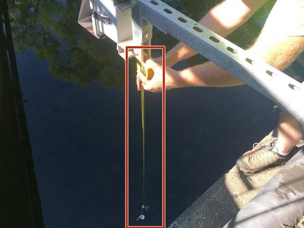 Using a (weighted) tape measure, measure and record the distance from the bottom of the depth sensor node to the bottom of the river.