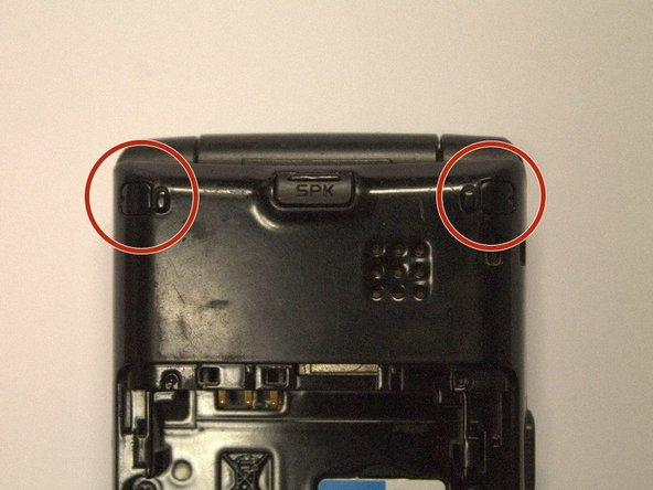 Using a spudger or other sharp tool, remove the two rubber pieces on the top of the back of the phone.