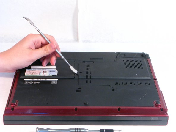 Use the flat Metal Spudger to open the plastic panel.