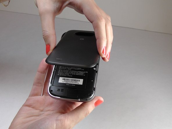 Remove the back cover of the phone to expose the phone's mid-frame.
