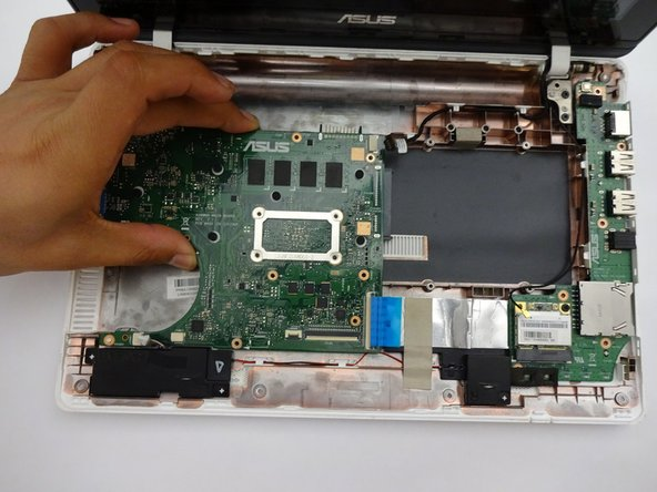 Once all screws and connectors are removed, gently lift the motherboard from computer.