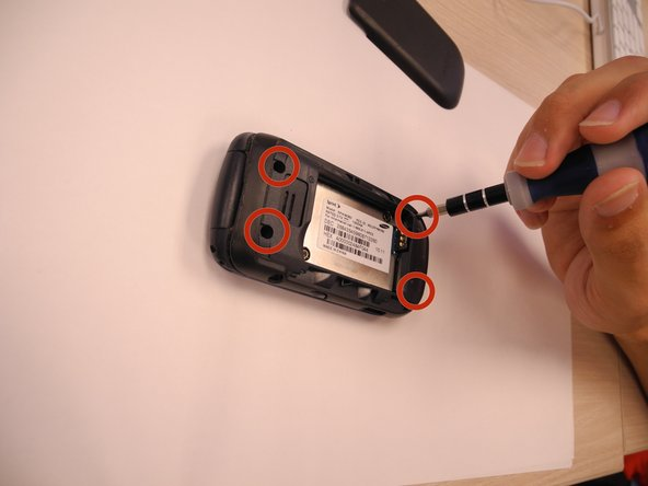 Use a phillips head (PH) #00 screwdriver to remove four screws connecting the two halves of the case.
