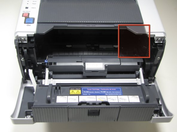 DO NOT TOUCH the electrodes on the right inner wall of the printer. Touching these electrodes can cause electrical damage to the printer.