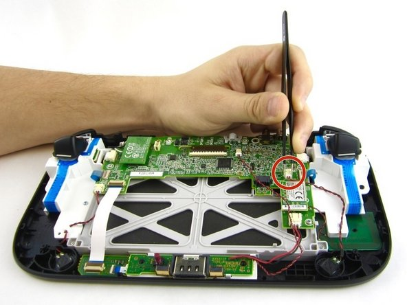 Remove the right speaker cable that's connected to the motherboard with the tweezers.