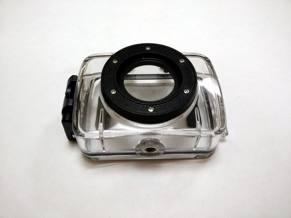 Place waterproof case on flat surface, with the lens cover facing up.