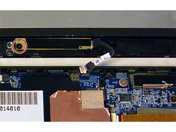 Remove the single 3 mm Phillips #000 screw on the left side of the module.