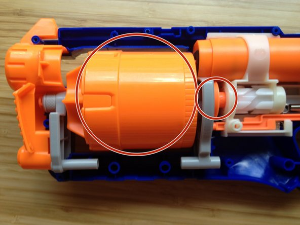 Remove the barrel that holds the Nerf darts.