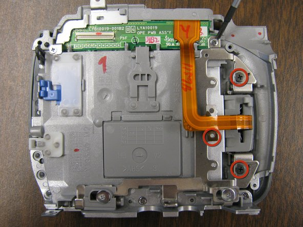 Remove 3 screws holding LCD screen hinge to base.