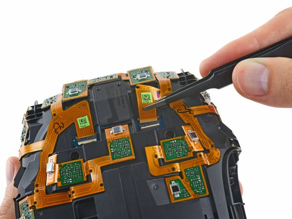With the outer sheath removed, we flip the switch on a few ZIF connectors to disconnect the IR photodiode webbing from the motherboard.