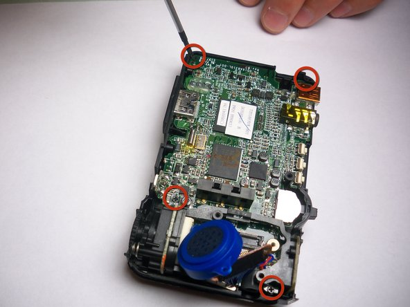 Remove the four screws holding on the motherboard.