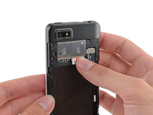 Use your finger to slide the SIM card straight down out of its tray.