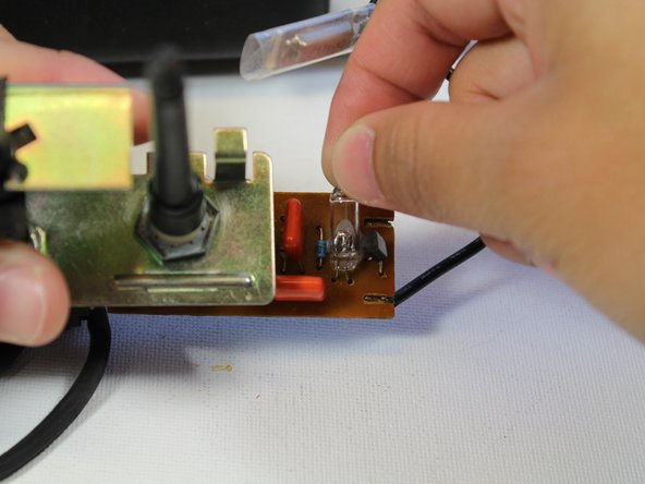 Remove the tip switch from the circuit board by pulling it away.