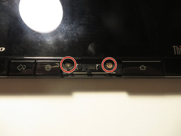 Remove these two 10mm screws with a Phillips head screwdriver using the #00 bit.
