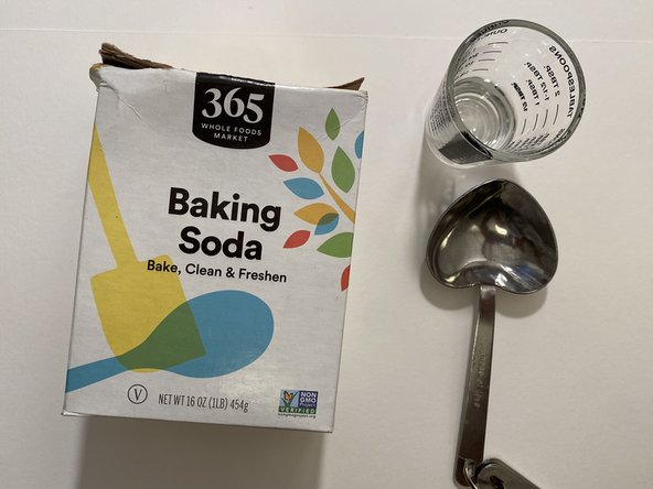 Use about 3 tablespoons of baking soda and 2 oz. of water. Mix the water and baking soda in a small bowl until you have paste with  a thick texture.