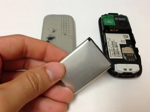 Remove the battery by wedging it out from the back.