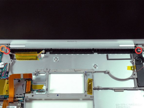 Support the display with one hand while removing the following 3 screws: