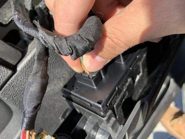 Re-plug wire harnesses into the new window switch panel and push panel into the cover.
