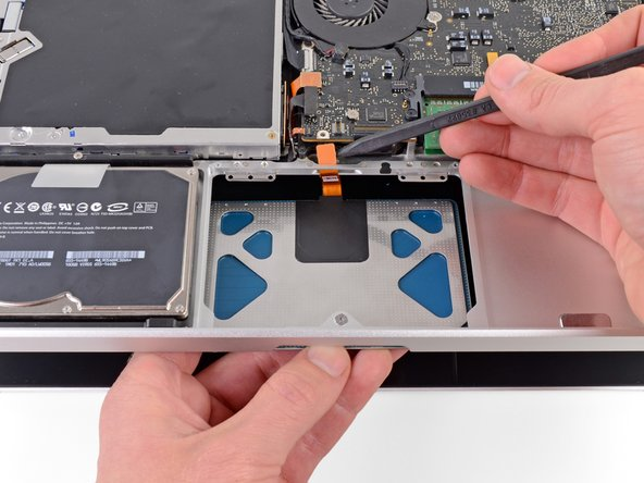 Carefully insert the cable from your new trackpad through its slot cut into the upper case.