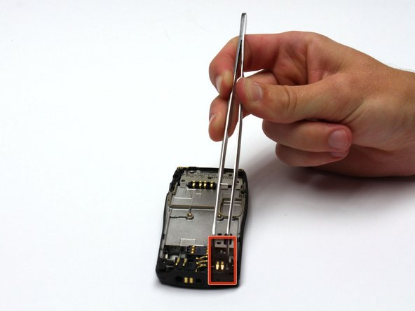 After removing the circuit board/faceplate sub-assembly, locate the vibrator mechanism.