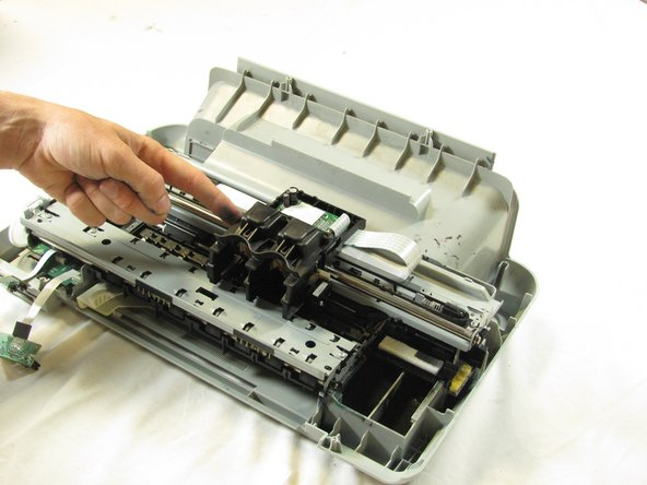 Slide the ink cartridge carriage all the way to the right side of the printer.
